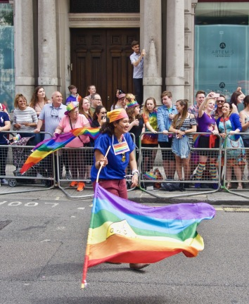 Waving a rainbow flag at Pride in London
