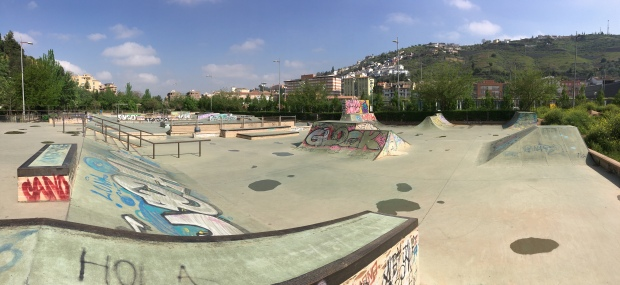Panoramic picture of the graffitied cement Skatepark Golden Ball in Granada
